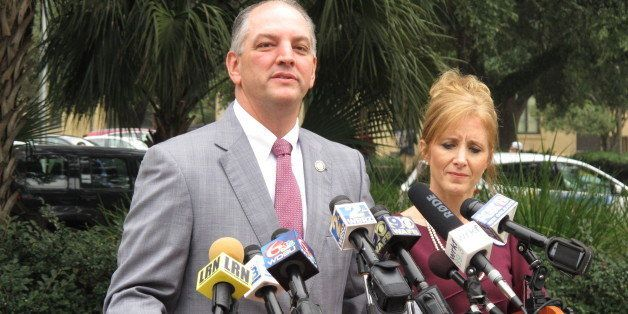 Democratic candidate for governor John Bel Edwards, with his wife Donna, speaks after Republican Lt. Gov. Jay Dardenne announ