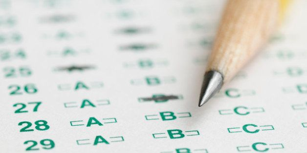 Optical scan answer sheet for school or standardized test with sharpened pencil tip.