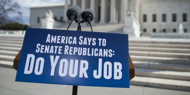 A sign calling on the Republicans in the Senate to hold confirmation hearings for Supreme Court Nominee Merrick Garland prior