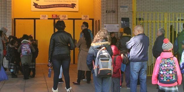 NEW YORK, NY - MARCH 9: Awaiting the opening of the school and the start of a school day, students gather in front of NYC cha