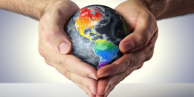 hands of two men formed a heart with the planet