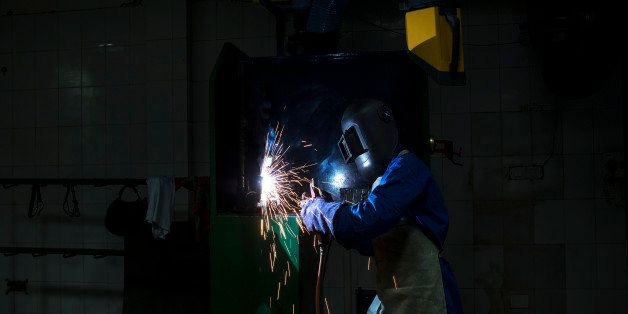 A student attends a welding class during vocational training at the Infrastructure Leasing & Financial Services (IL&FS) Insti