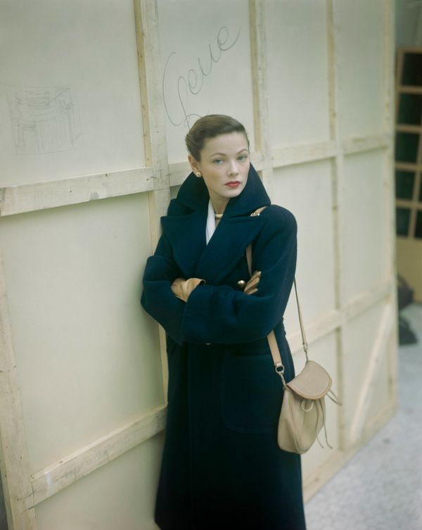 The actress wears a navy blue high-collared coat in this undated photo.