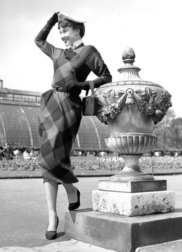 Hepburn leans on an ornate urn in Kew Gardens, Queens, in 1950.