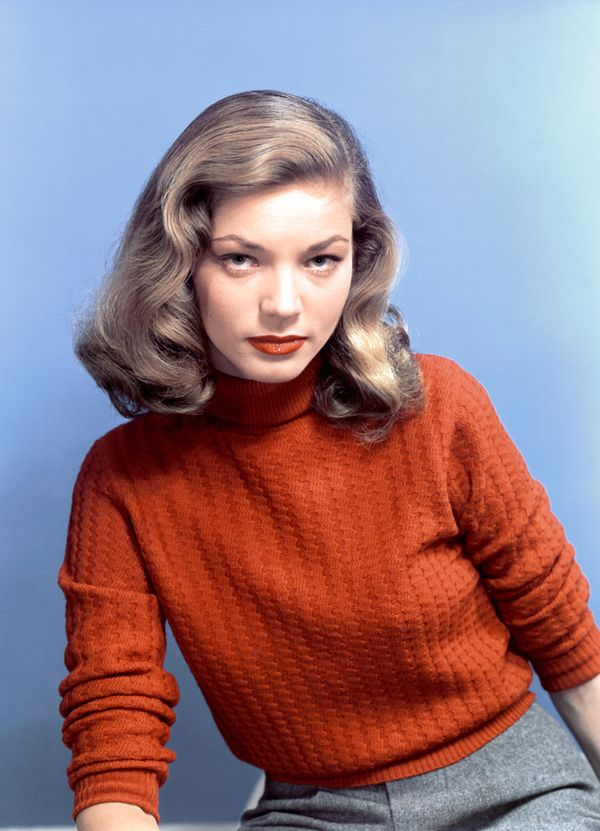 Bacall in a red-orange turtleneck in an undated portrait.