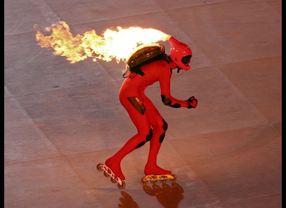 What's better than a guy in a full bodysuit on rollerblades? A guy ON FIRE in a full bodysuit on rollerblades  (Photo by Ke