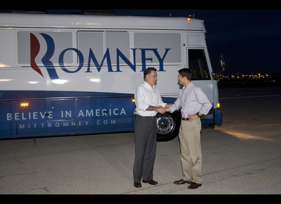 US Republican presidential candidate and former Massachusetts Governor Mitt Romney (L) shakes hands with his running mate Wis