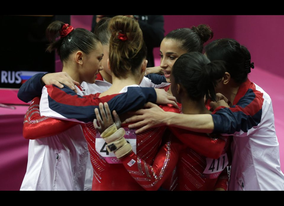 U.S. gymnasts huddle together after their performance during the Artistic Gymnastics women's team final at the 2012 Summer Ol