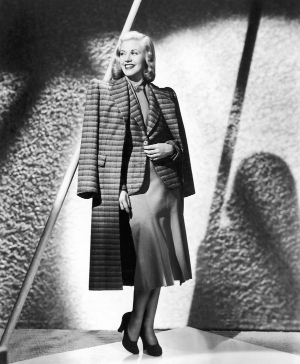 The actress and dancer wears a three-piece suit in this 1938 photo.
