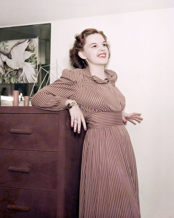 Garland wears a striped dress in this images from around 1940.