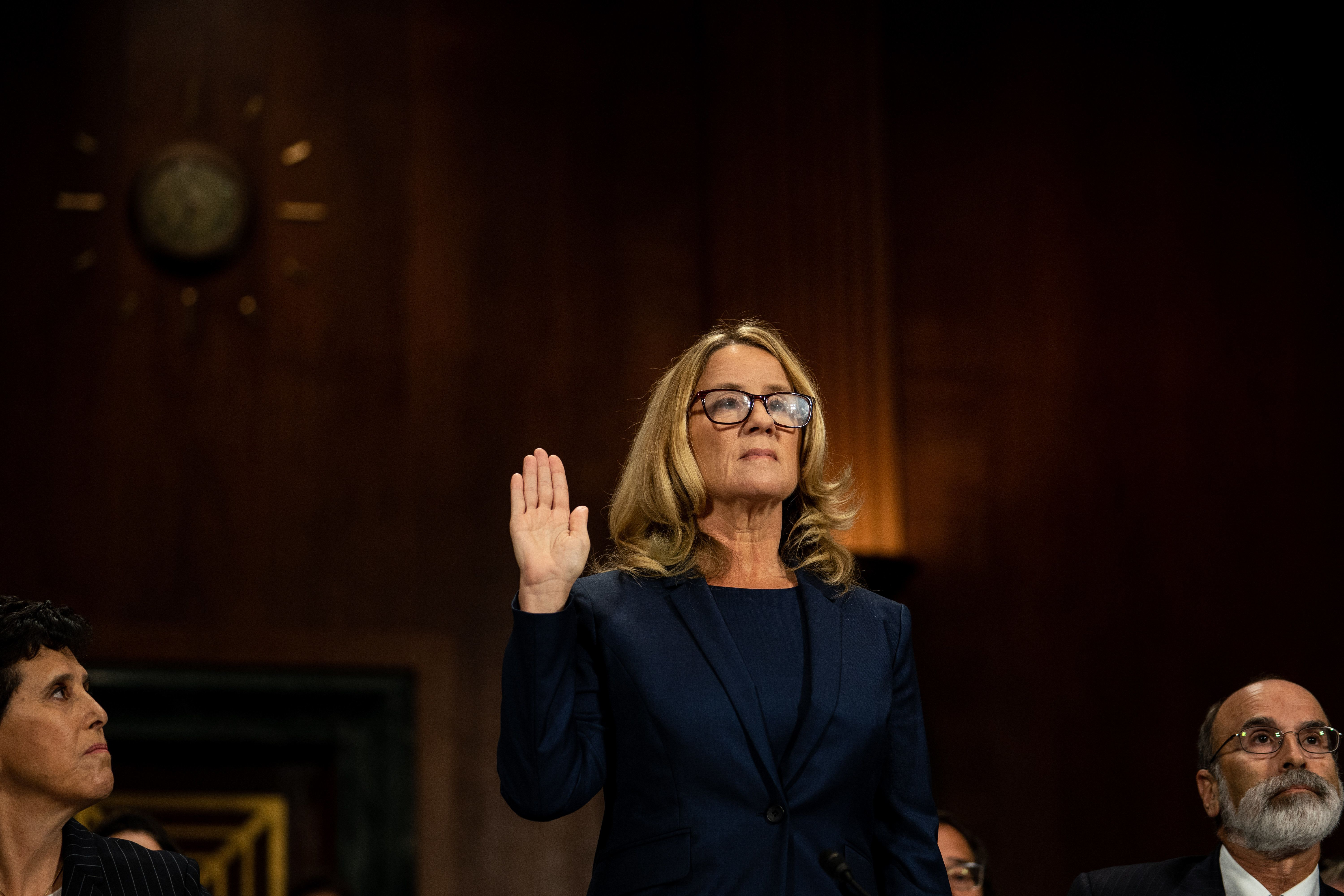 WASHINGTON, DC - SEPTEMBER 27:  Christine Blasey Ford is sworn in prior to giving testimony before the U.S. Senate Judiciary Committee at the Dirksen Senate Office Building on Capitol Hill September 27, 2018 in Washington, DC. Blasey Ford, a professor at Palo Alto University and a research psychologist at the Stanford University School of Medicine, has accused Supreme Court nominee Brett Kavanaugh of sexually assaulting her during a party in 1982 when they were high school students in suburban Maryland.