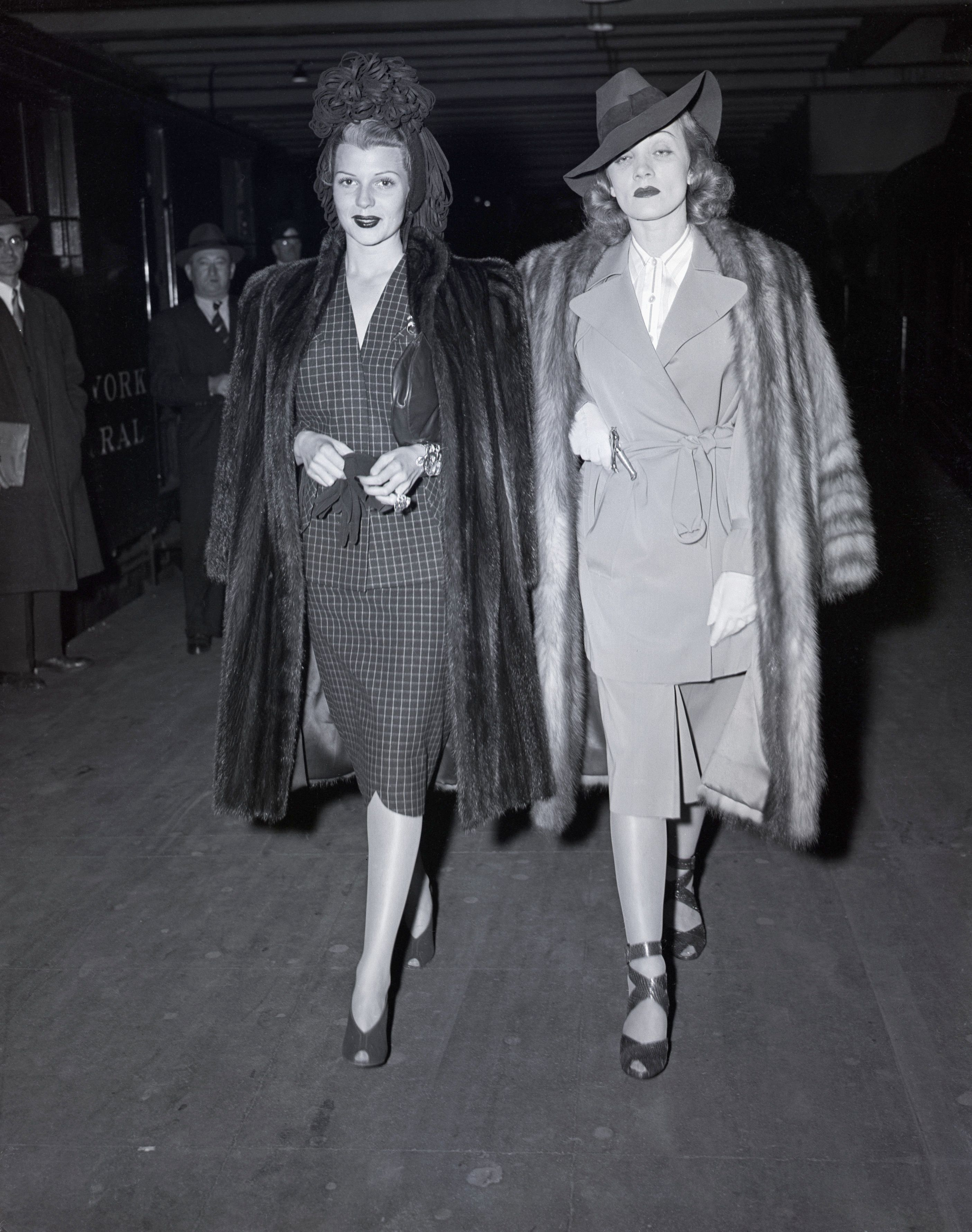 (Original Caption) 11/8/1941-New York, NY-Rita Hayworth and Marlene Dietrich, Columbia Pictures glamour stars, depart for Hollywood after a New York visit, during which they shone at various affairs -- the big town is a bit duller now.