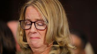 WASHINGTON, DC - SEPTEMBER 27: Professor Christine Blasey Ford, who has accused U.S. Supreme Court nominee Brett Kavanaugh of a sexual assault in 1982, gets emotional while testifying before a Senate Judiciary Committee confirmation hearing for Kavanaugh on Capitol Hill September 27, 2018 in Washington, DC. A professor at Palo Alto University and a research psychologist at the Stanford University School of Medicine, Ford has accused Supreme Court nominee Judge Brett Kavanaugh of sexually assaulting her during a party in 1982 when they were high school students in suburban Maryland. (Photo by Jim Bourg-Pool/Getty Images)