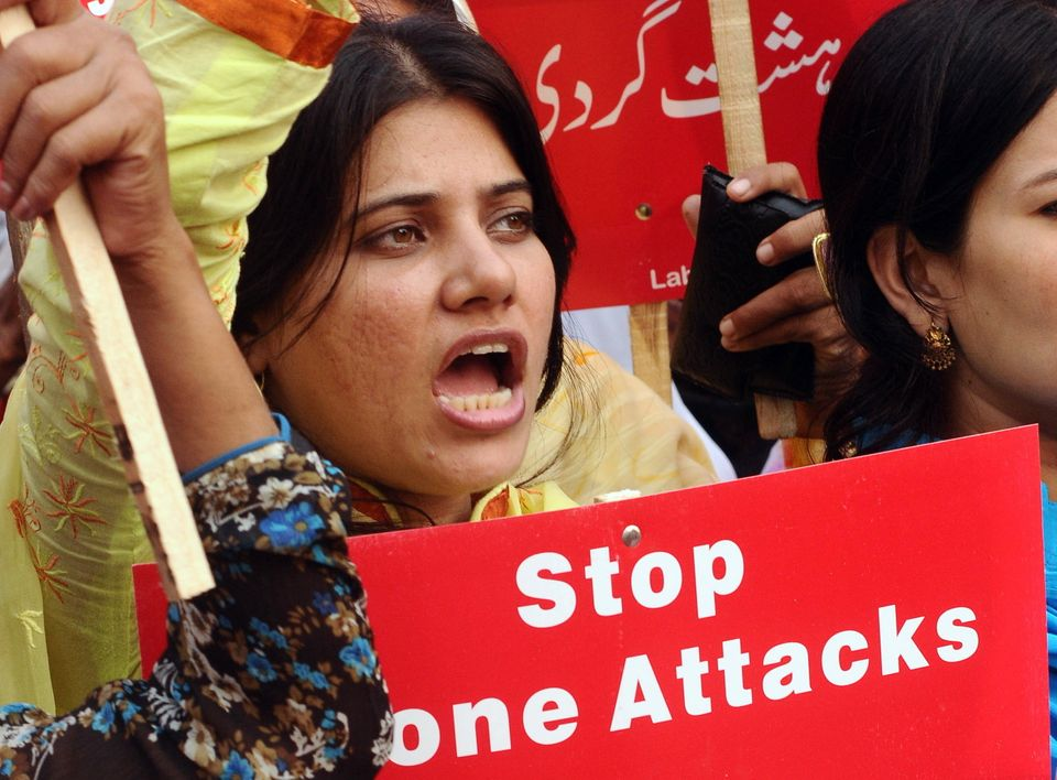 Pakistani NGOs workers shout slogans against US drone attacks and religious fundamentalism during a protest in Lahore on Octo