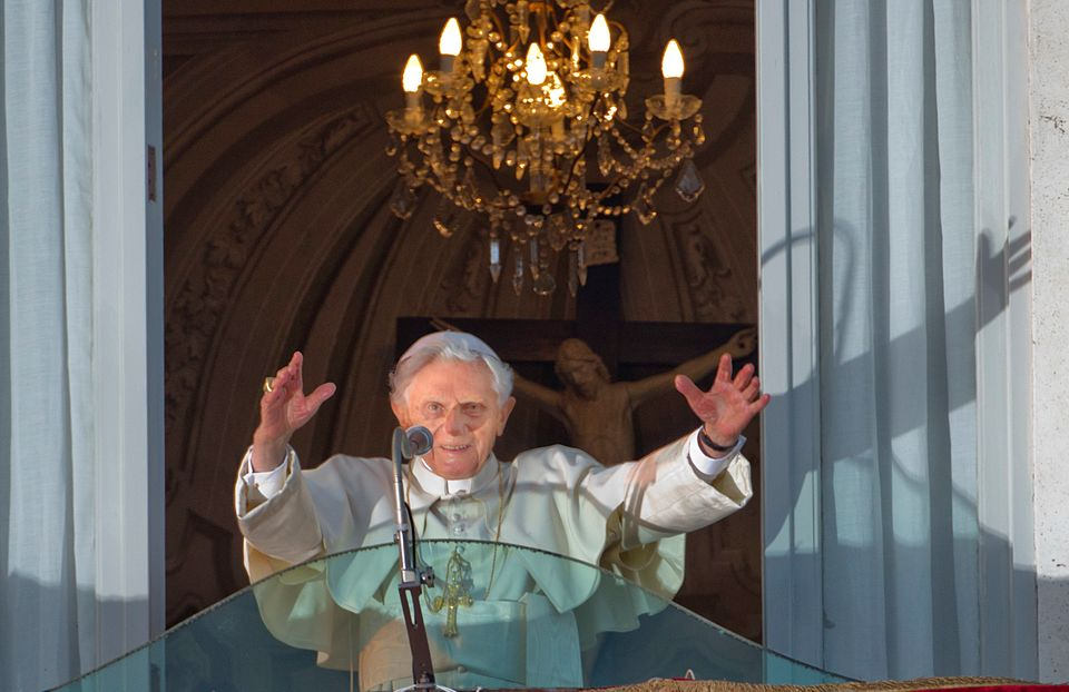 Pope Benedict XVI waves from the balcony window of the Pontifical summer residence in Castel Gandolfo, some 35 kilometers sou