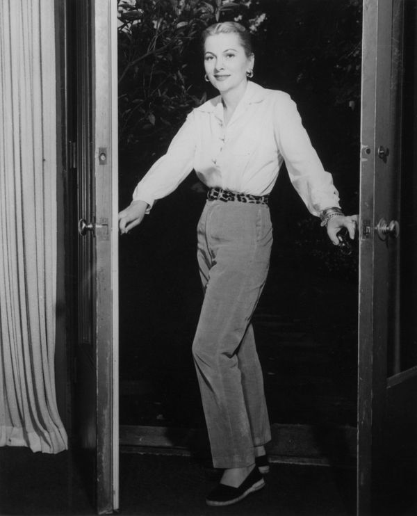 Fontaine wears casual separates at home in this photo from sometime in 1957.