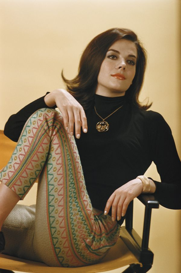 Wood wears a black turtleneck with printed pants in the 1961 photo.