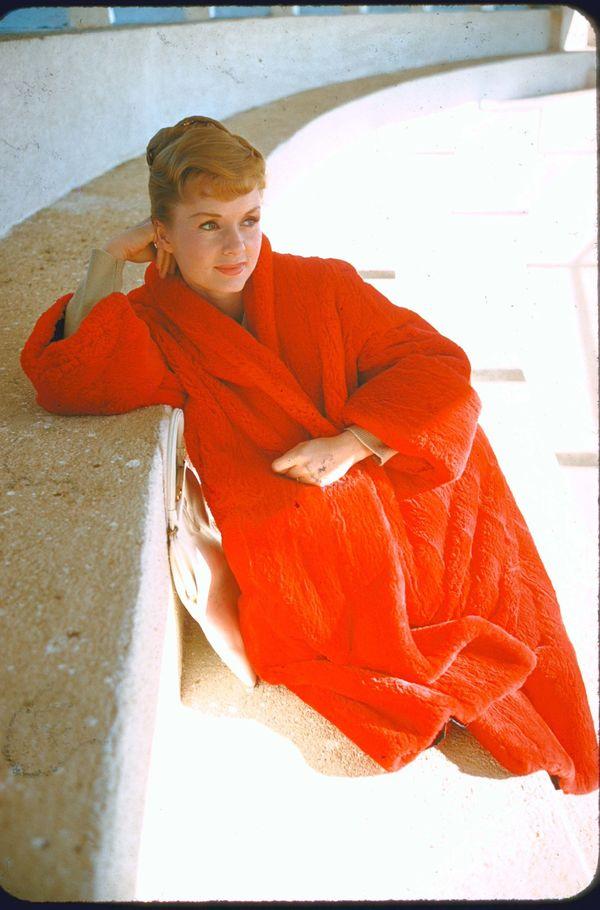Reynolds wears a bright red fuzzy coat in this undated photo.