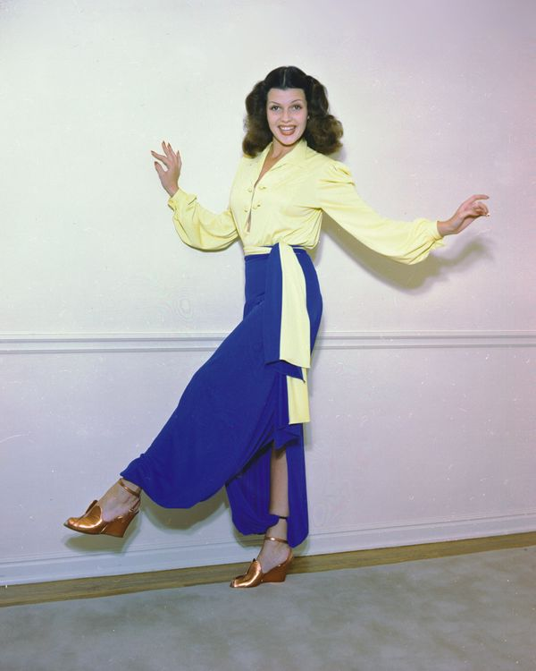 Hayworth wears a yellow blouse and blue harem pants in this photo taken sometime in the 1940s.