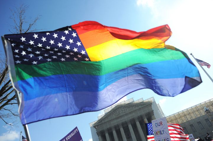 Same-sex marriage supporters wave a rainbow flag in front of the US Supreme Court on March 26, 2013 in Washington, DC. The US