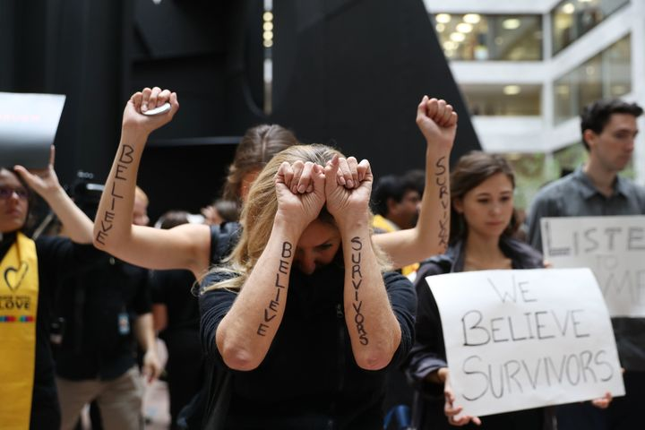 "Protesters display notes written on their arms reading ""Believe Survivors"" while demonstrating ahead of a Senate Judiciary Co"