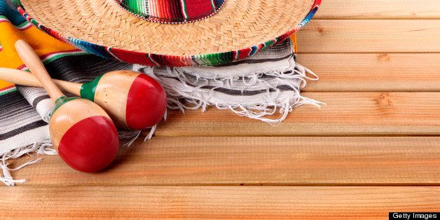 Mexican serape rug, sombrero and maracas
