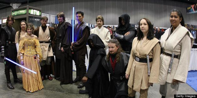 Los Angeles, UNITED STATES: Star Wars fans pose for a photo during the opening day of 'Star Wars Celebration IV' in Los Angel