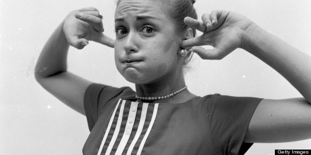 circa 1955:  Holding a mouth full of air and plugging up the ears is another method for stopping an attack of hiccups.  (Phot