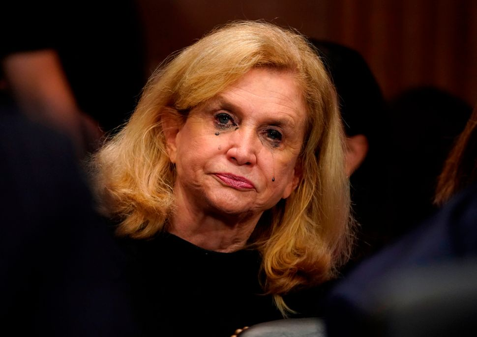 "Rep. Carolyn Maloney (D-N.Y) cries as Christine Blasey Ford testifies. Blasey described ""the uproarious laughter between"