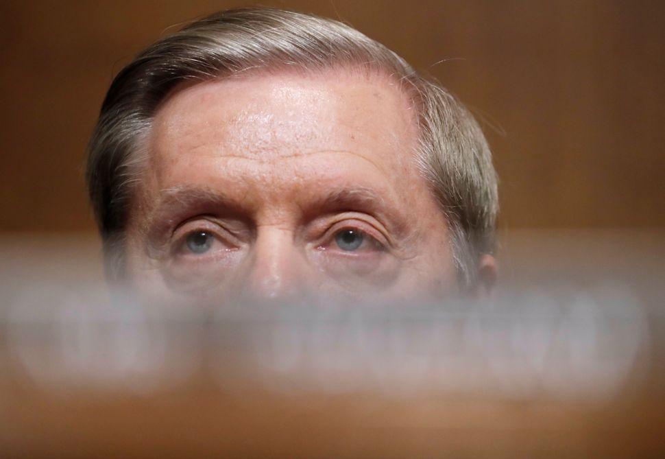 U.S. Senator Lindsey Graham (R-SC) listens as Blasey testifies.