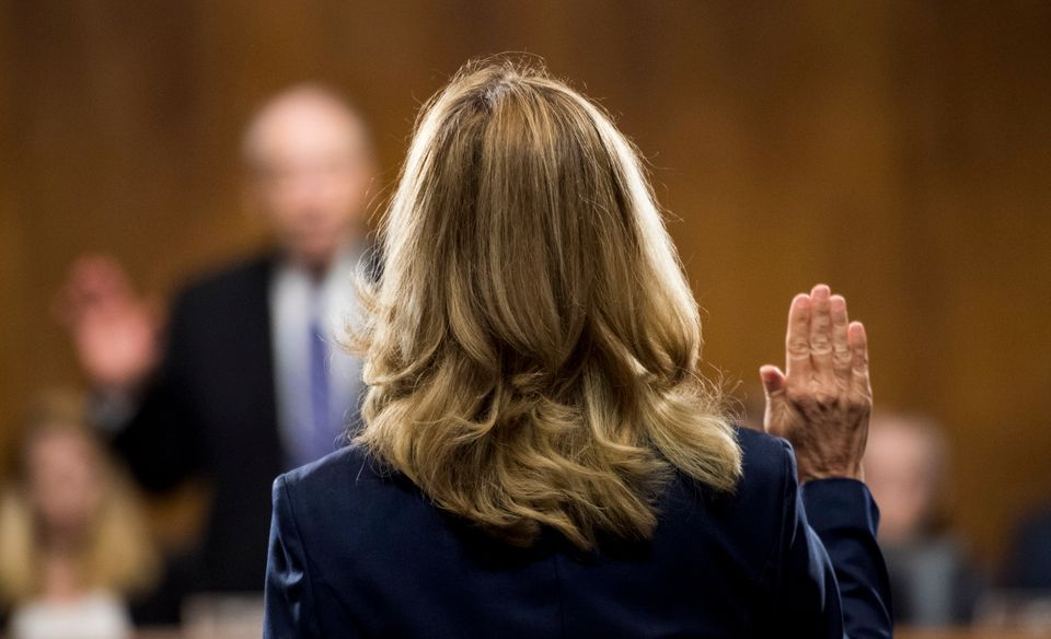 Dr. Christine Blasey Ford is sworn in by committee chairman Chuck Grassley, (R-Iowa).
