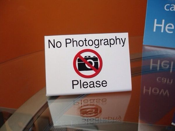 "Including signs that say ""no photography."""