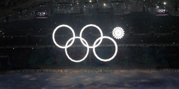 SOCHI, RUSSIA - FEBRUARY 07:  Snowflakes transform into four Olympic rings with one failing to form during the Opening Ceremo