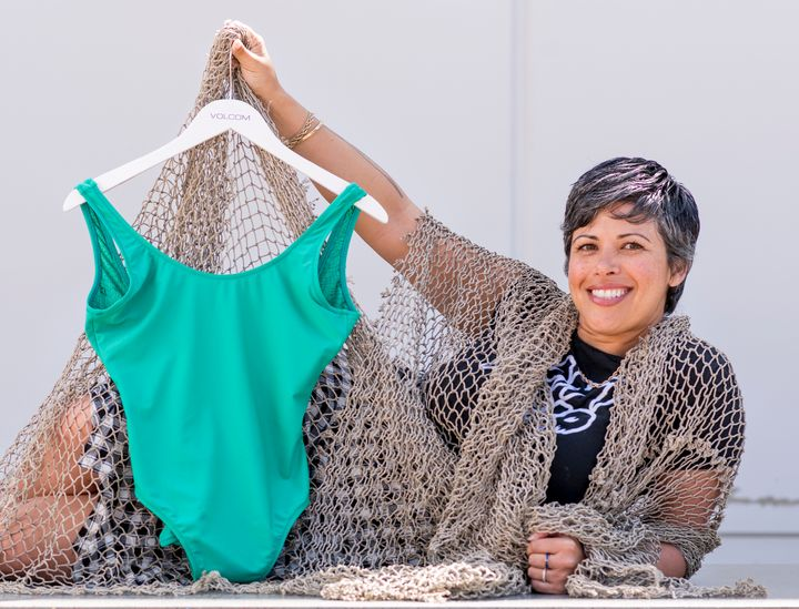 Marina Hamm, a designer and merchandiser for Volcom, displays one of the brand's bathing suits made from recycled fishing net