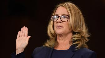 Christine Blasey Ford swears in before testifying in front of the US Senate Judiciary Committee confirmation hearing on Capitol Hill in Washington, DC, U.S., September 27, 2018. Saul Loeb/Pool via REUTERS