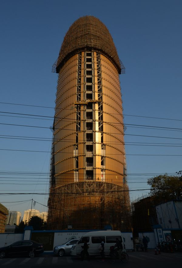 The headquarters of the People's Daily newspaper in Beijing, China, gave people the shaft daily while it was under constructi