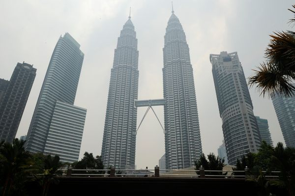 """Johnson"" and ""Johnson""? Malaysia's Petronas Twin Towers in Kuala Lumpur proudly rise 452 meters above street level."