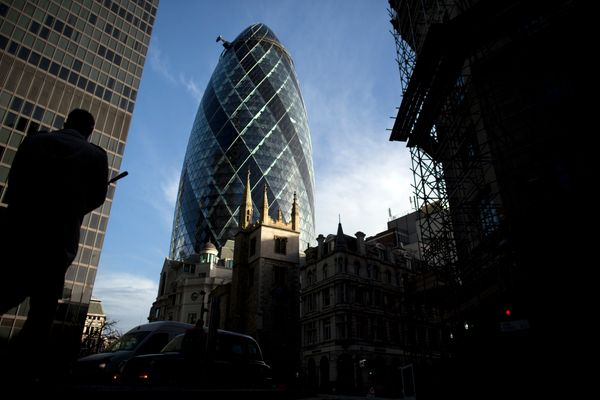"London's 30 St Mary Axe, affectionately known as ""The Gherkin,"" keeps a stiff upper well, you know. It's <a href=""http://www."