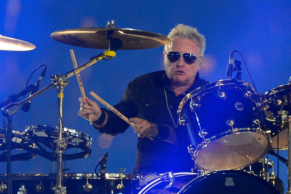 Queen drummer Roger Taylor performs at the Olympic stadium during the closing ceremony of the 2012 London Olympic Games in Lo