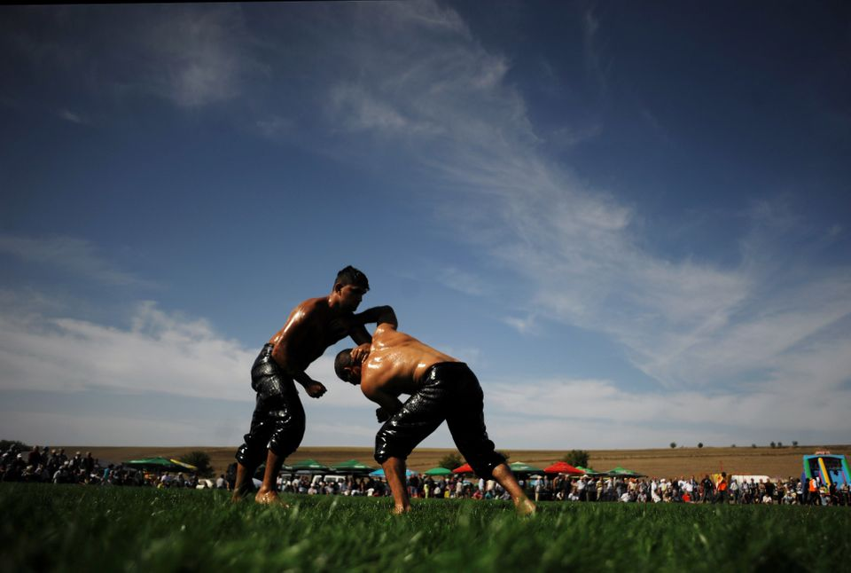 Bulgarian oil wrestlers, known as pehlivans, fight on September 30, 2012 during a traditional oil wrestling competition near