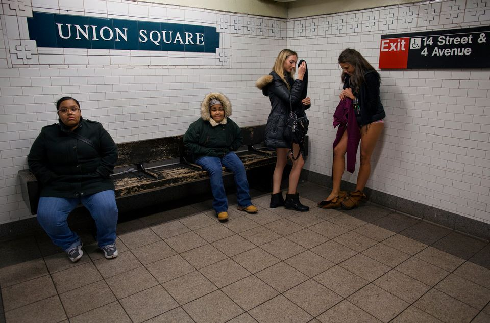 Marianne Cornejo, far right, and Leah Estreicher, center right, both of New York, start to get dressed at the Union Square su