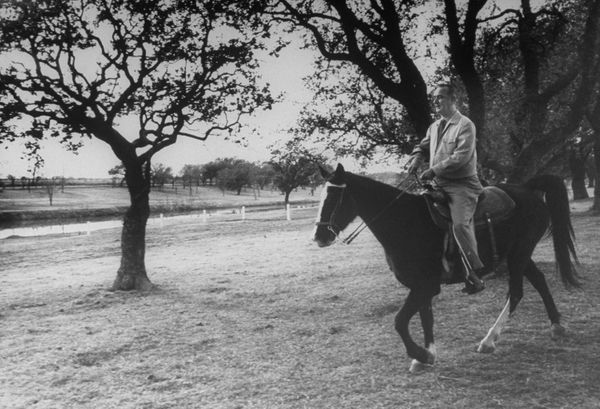 Lyndon B. Johnson riding his Tennessee Walking Horse as he surveys the ranch he bought in 1951.