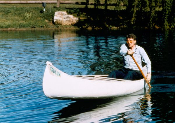 Ronald Reagan paddles a canoe while at his ranch in April 1985 near Santa Barbara, California. Reagan canoed and rode horses