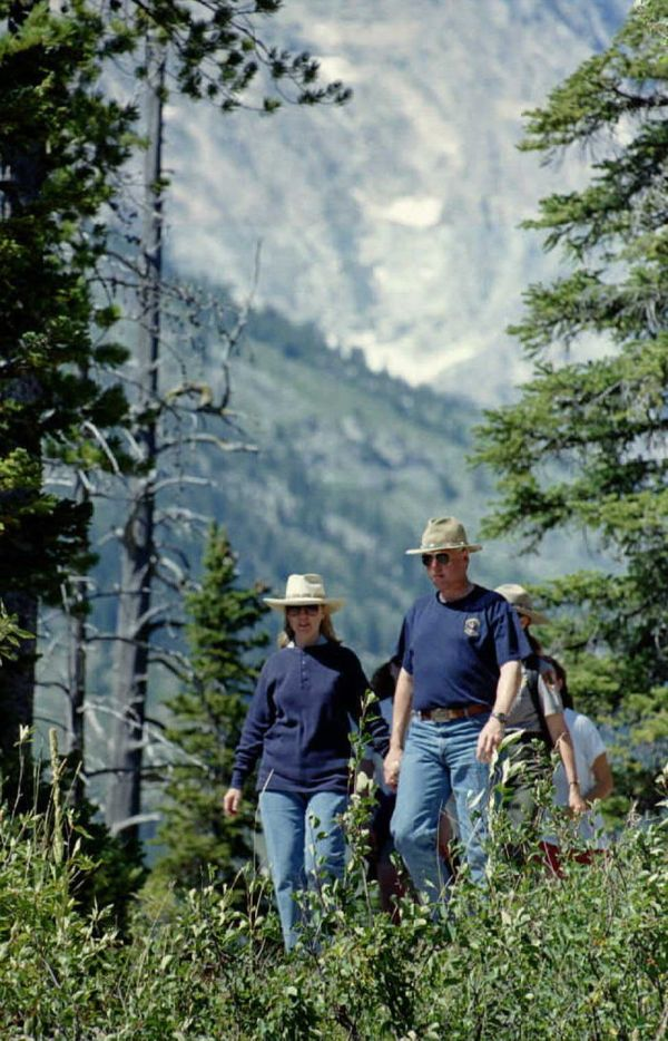 Bill and Hillary Clinton hike through Wyoming's Grand Teton National Park on August 20, 1995.