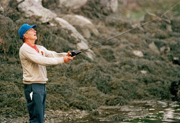 George H.W. Bush fishing in the Kennebunk River in Kennebunkport, Maine on July 3, 1989.
