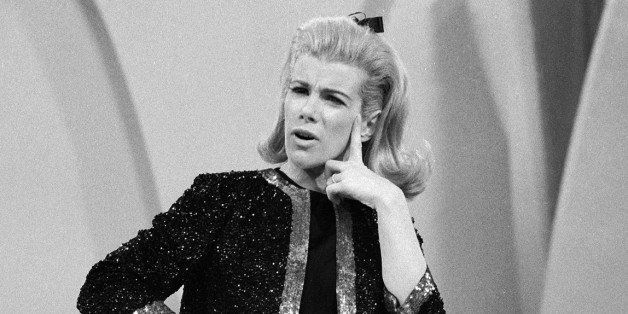 American comedienne Joan Rivers strikes a puzzled pose while performing her act on 'The Ed Sullivan Show,' New York, New York