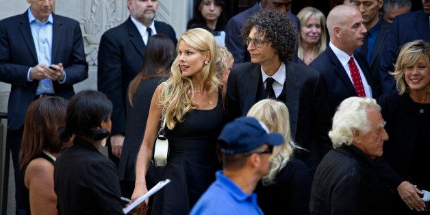 Howard Stern, center right, and his wife Beth depart a funeral service for comedian Joan Rivers at Temple Emanu-El in New Yor