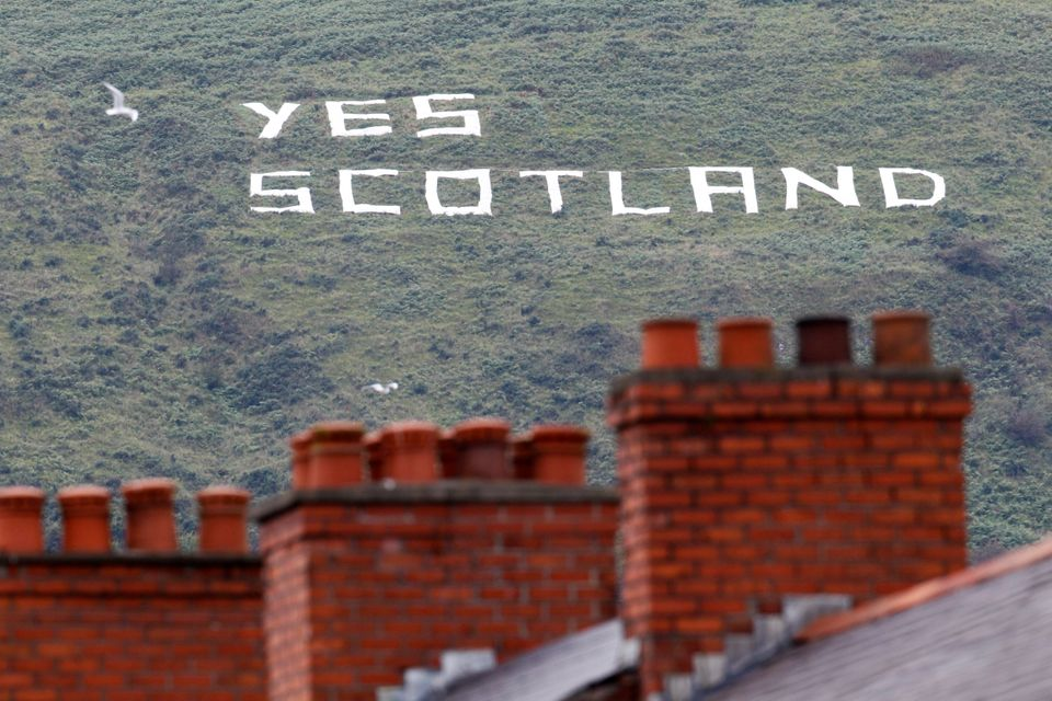 Writing in support of the Yes vote in the Scottish independence referendum is pictured on a mountain in West Belfast, Norther