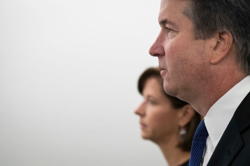 Ashley Kavanaugh holds hands with her husband, Supreme Court nominee Judge Brett Kavanaugh, as they arrive for his testimony