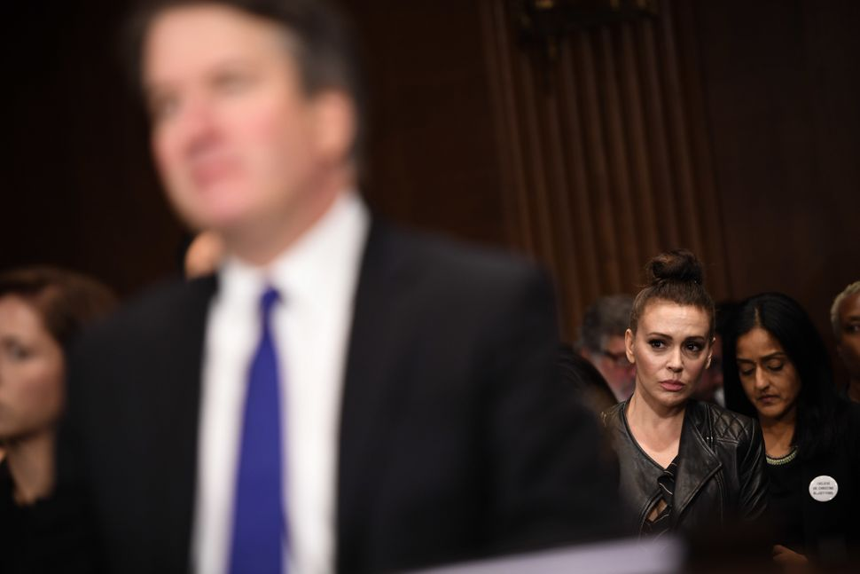 Actress Alyssa Milano (second from right), a prominent figure in the Me Too movement, listens to Kavanaugh.